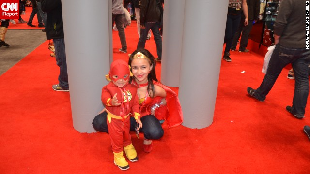 "The Flash (looking more adorable than usual here) <a href='http://ireport.cnn.com/docs/DOC-1047486'>poses with Wonder Woman</a> (sometimes referred to as ""Mommy"")."