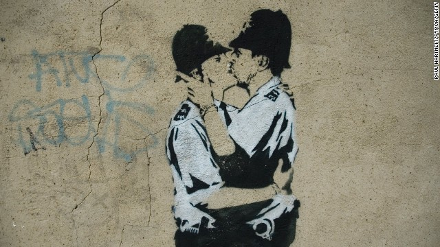 A stenciled image of two policemen kissing is seen in London in 2005.