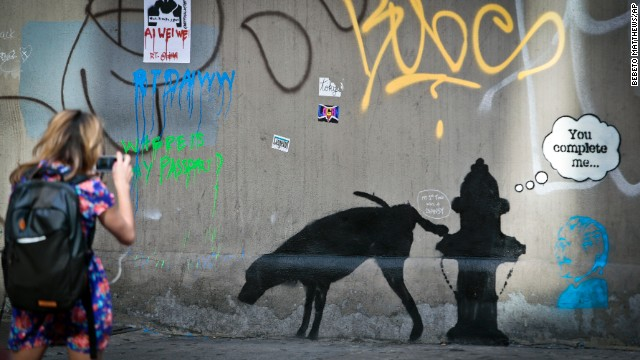 A Banksy mural of a dog urinating on a fire hydrant draws attention October 4.