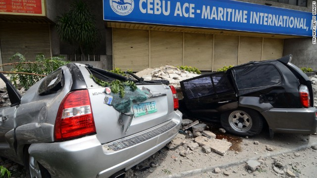 Cars damaged by falling debris in Cebu City after a 7.1 magnitude earthquake struck the region on October 15.