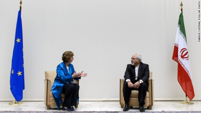 EU's Catherine Ashton talks to Iran's Mohammad Javad Zarif prior to the start of nuclear talks Tuesday, October 15 in Geneva.