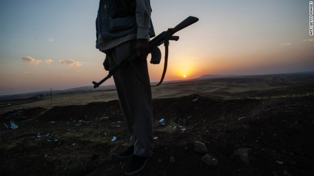 A Syrian policeman patrols the border between Syria and Iraq on Monday.