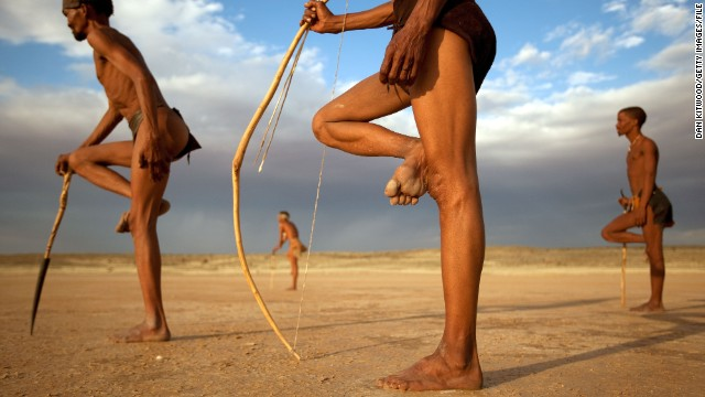 Men from the Khomani San community strike traditional poses in South Africa's Kalahari Desert. The desert is also home to a space shuttle emergency landing strip, a 4.9-kilometer-long runway at Upington Airport.