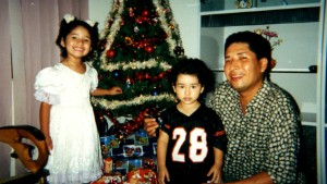 Ronald Soza and his children pose in a family Christmas photo.
