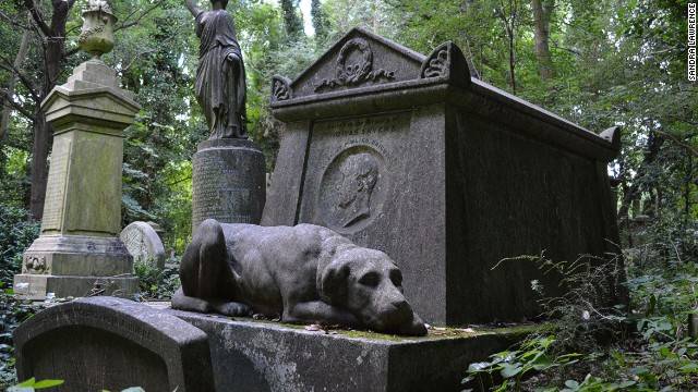 At Highgate Cemetery, bare-knuckle boxing champ Tim Sayer is guarded in the hereafter by his pooch.