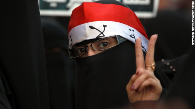 A woman pictured on the anniversary of protests against former Yemeni president on September 18.