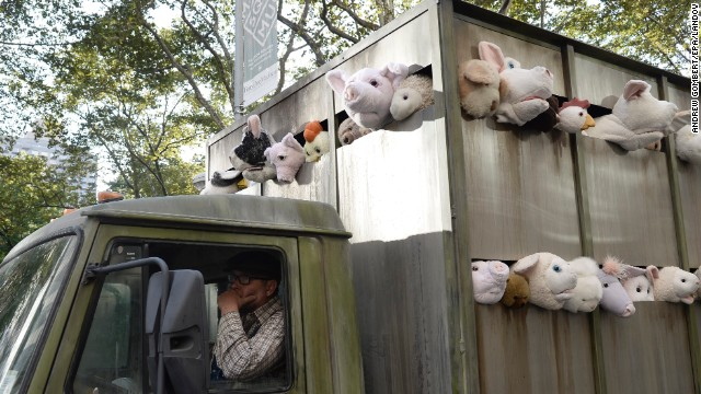 "Banksy's ""Sirens of the Lambs"" art installation tours the streets of Manhattan on October 14. It's a fake slaughterhouse delivery truck full of stuffed animals."