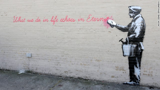 "A Banksy mural is seen October 14 on a wall in Queens. The quote is from the movie ""Gladiator."" It says, ""What we do in life echoes in eternity."""