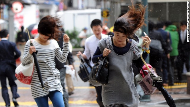 Tokyo commuters struggle to get to work.