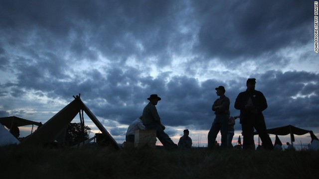 Union Civil War re-enactors await nightfall while camped at the Gettysburg National Military Park on the 150th anniversary of the historic battle on July 1, 2013. One Gettysburg-related ghost tour is offered by a former park ranger.