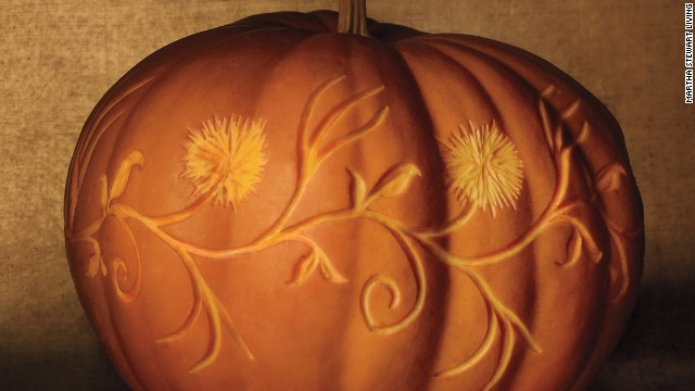 This carving is all about size and subtlety: The squatness of the large squash is ideal for a looping horizontal design, and the low contrast in hue between carved and uncarved flesh plays up the fluffy, textural mums.