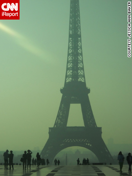 "Tourists take in the Eiffel Tower on a <a href='http://ireport.cnn.com/docs/DOC-954301'>hazy spring day</a>. ""There really is just something amazing about Paris in the springtime,"" said Jessica Ann Baker."