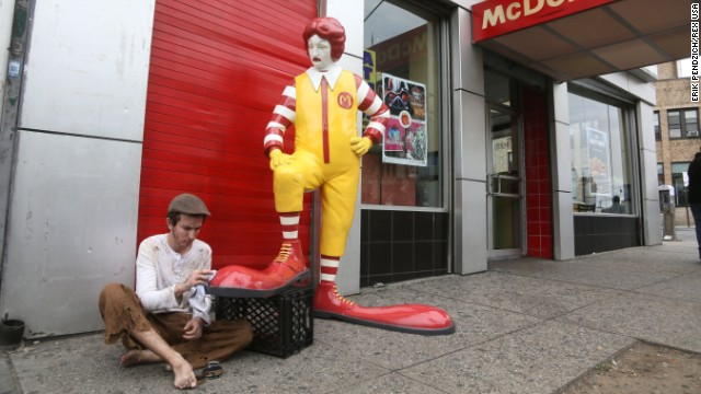 One of Banksy's latest pieces is this fiberglass sculpture of Ronald McDonald having his shoes shined in front of a McDonald's.