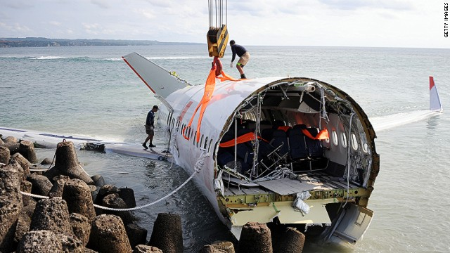 Workers retrieve a section of a Lion Air Boeing 737 which crashed in Bali, April 17, 2013. Dozens were injured but there were no fatalities.