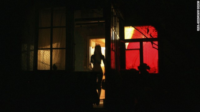 The countries of the former Soviet Union, such as Kazakhstan, where this sex worker is pictured outside a brothel, have been a source of trafficked women. In Russia, researchers estimate more than 500,000 people exist in conditions of modern day slavery, its large economy drawing vulnerable workers from former Soviet Republics and Eastern Europe.