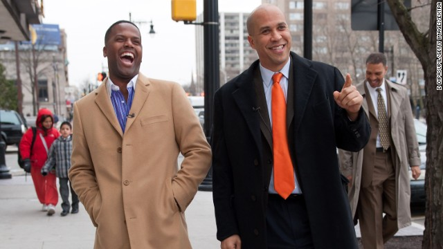 "Booker and television personality A.J. Calloway walk the streets of Newark during a taping of ""Extra"" on January 15."