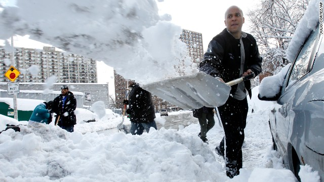 "Booker digs out Newark resident Jasmine Ingram's vehicle in January 2011. ""It was very nice. I didn't expect it, so it was shocking,"" said Ingram, who was one of four people to have their vehicles dug out by the mayor and a group of residents."