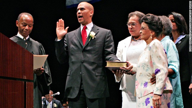 Booker takes the mayoral oath of office from retired New Jersey Supreme Court Justice James H. Coleman, left, in July 2006.