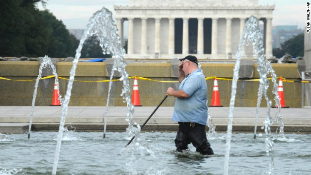 A worker cleans the fountain at the National World War II Memorial in Washington on October 17. The Lincoln Memorial is in the background.
