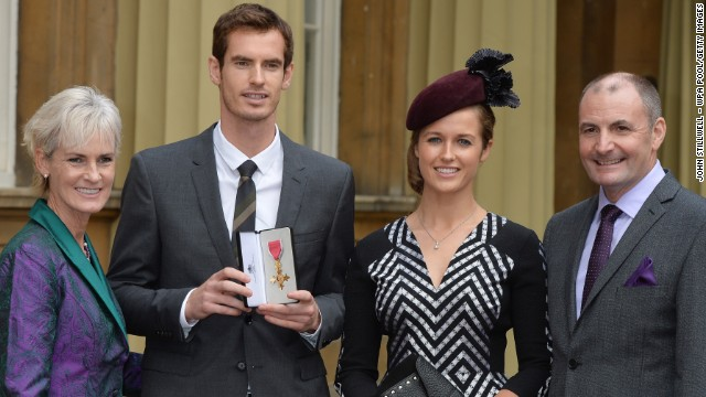Andy Murray, second from left, received an OBE Thursday in front of his girlfriend and parents.