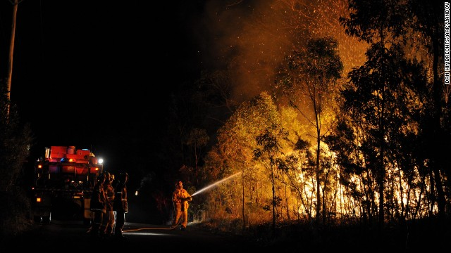 Firefighters fought scores of bush fires in New South Wales early on October 18.