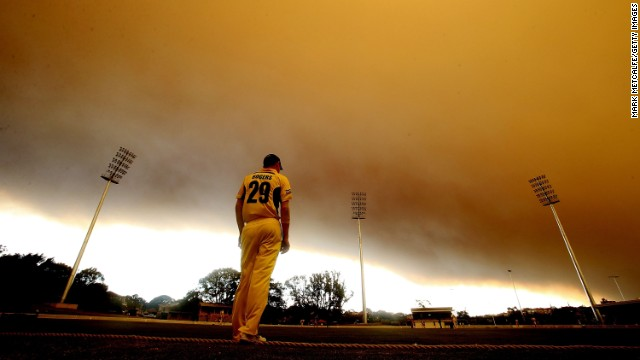 Smoke shrouds a cricket match between the Western Australia Warriors and the South Australia Redbacks during their Ryobi Cup match October 17 at Drummoyne Oval.