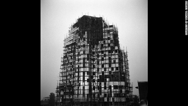"An image by Ethiopian photographer Michael Tsegaye, from the series ""Future Memories."" It depicts a new office building under construction in Addis Ababa."