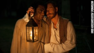 Chiwetel Ejiofor, left, stars as Solomon Northup and Michael Fassbender stars as Edwin Epps in \