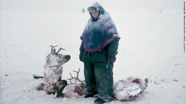A Sami in Sweden mourns the loss of two reindeer that starved after locking horns in a fight for dominance, in this remarkable photograph by Erika Larsen.