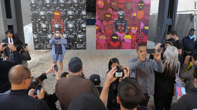 A crowd gathers to view Banksy artwork in New York City's Chelsea neighborhood on October 18.