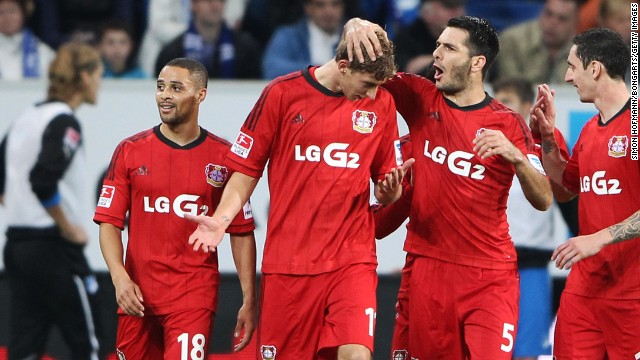 Kiessling clearly has mixed feelings as he is congratulated by teammates after the controversial award of the goal.