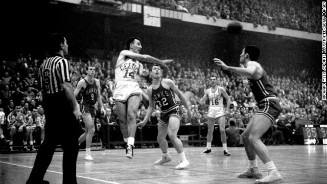 Boston Celtics great Bob Cousy makes a pass against the St. Louis Hawks in 1957. Cousy sold just about all the uniforms and memorabilia in his basement for around $320,000, which he gave to his two daughters, says Bob Greene.