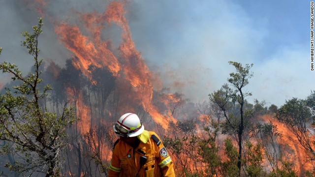 A firefighter puts in containment lines on the Darling Causeway, near Bell, Australia, on October 21.