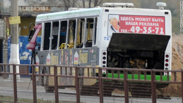 A damaged passenger bus sits on a road after an explosion in Volgograd, Russia, on Monday.
