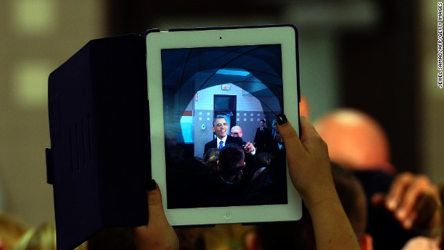 A student uses her iPad to take a picture of President Barack Obama as he greets students at a middle school in Mooresville, North Carolina, on June 6, 2013.