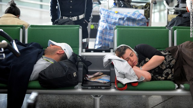 """There are a few 'beds' made of four seats together (no armrests),"" writes one airport sleeper ecstatically."