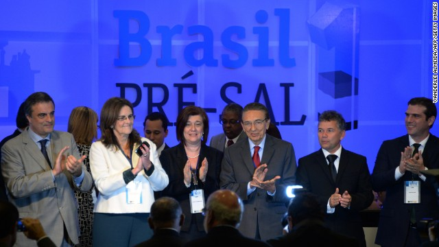 Brazilian government representatives celebrate with Petrobras President Maria das Gracas Silva Forster (second left) at the end of the auction to develop the Libra oil field in Rio de Janeiro on Monday.