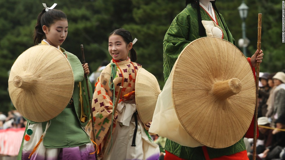 People dressed in authentic costumes representing various periods and characters in Japanese feudal history participate in the annual Jidai Festival at Kyoto Imperial Palace on Tuesday, October 22, in Kyoto, Japan.