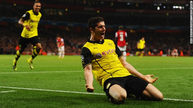 Robert Lewandowski celebrates scoring Borussia Dortmund's winner against Arsenal at the Emirates Stadium.
