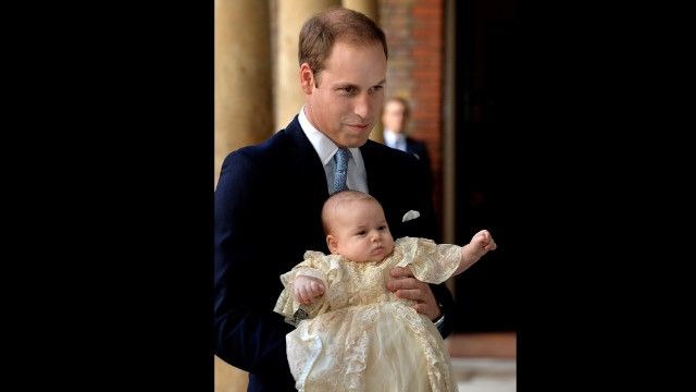 Prince William holds Prince George ahead of the christening.
