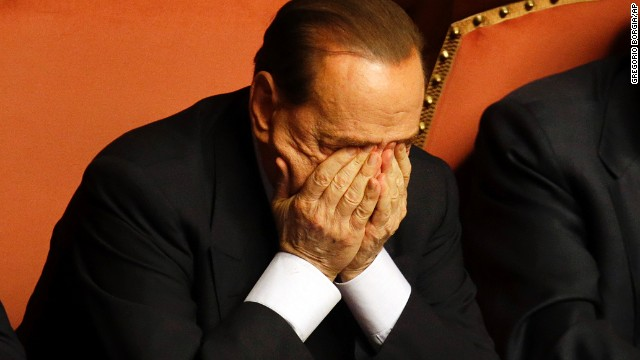 Berlusconi rubs his eyes after delivering a speech at the Senate in Rome on October 2.
