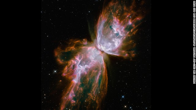 The Butterfly Nebula, or NGC 6302, features rolling cauldrons of gas heated to temperatures higher than 36,000 degrees Fahrenheit. A dying star ejected its envelope of gasses to form the nebula with its winglike formation.