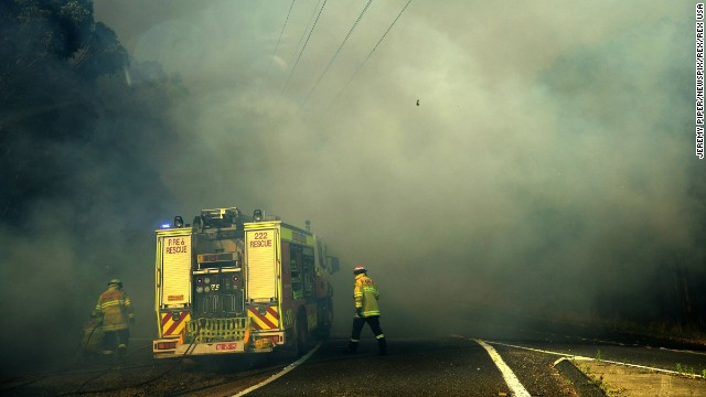 Firefighters battle the front line in Lake Macquarie on October 23.