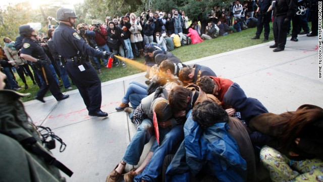 University of California, Davis, Police Lt. John Pike uses pepper spray to break up Occupy UC Davis protesters on the school's quad in Davis, California, on November 18, 2011. This image sparked controversy amid the Occupy protests and fueled the flames for protestors. A judge ruled that the university must pay Pike $38,000 in workers' compensation for the depression and anxiety he suffered as a result of the backlash from the incident.