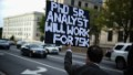 An unemployed worker holds a up sign on a street corner in Washington, DC.