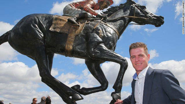 Nolen stands alongside the sculpture of the horse which he rode to 22 of her 25 victories.