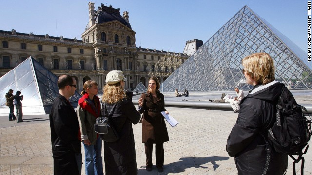 The Louvre is a beautiful place ... for scam artists. Tour guides can help you spot them. Hmm. That guy look kind of sketchy to you?