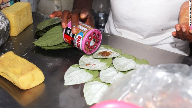 He sprinkles tobacco on each leaf, adding to the addictive nature of the betel quid.