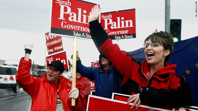 Palin stands in the rain in Anchorage in August 2006 as she campaigns for the Republican gubernatorial nomination. Palin defeated incumbent Frank Murkowski and former state legislator John Binkley win the race.