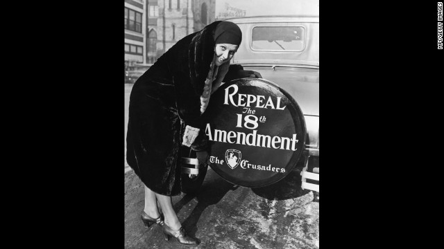 Prohibition might have been at its peak in 1927, although it would not be repealed until 1933. Pictured here in 1927, a woman shows off a sign on the wheel on the back of her car that urges the repeal of the 18th Amendment.